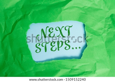 Text sign showing Next Steps. Conceptual photo something you do after you have finished doing first one Green crumpled ripped colored paper sheet centre torn colorful background. #1509152240