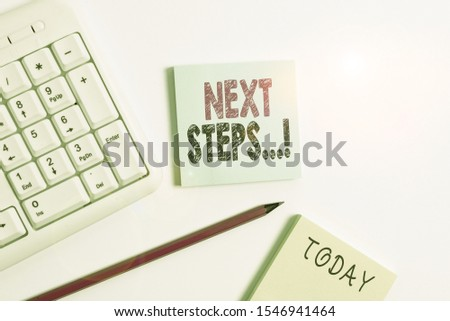 Text sign showing Next Steps. Conceptual photo something you do after you have finished doing first one White pc keyboard with empty note paper and pencil above white background. #1546941464