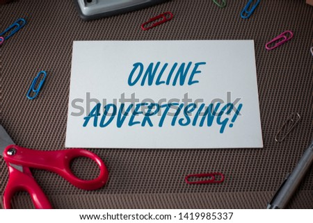 Text sign showing Online Advertising. Conceptual photo Internet Web Marketing to Promote Products and Services Scissors and writing equipments plus plain sheet above textured backdrop.