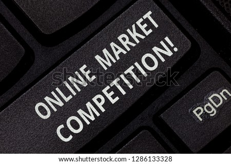 Text sign showing Online Market Competition. Conceptual photo Rivalry between companies selling same product Keyboard key Intention to create computer message pressing keypad idea. #1286133328