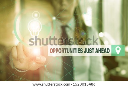 Text sign showing Opportunities Just Ahead. Conceptual photo Advantageous circumstances Perseverance pays off Female human wear formal work suit presenting presentation use smart device.