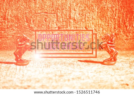 Text sign showing Opportunities Just Ahead. Conceptual photo Advantageous circumstances Perseverance pays off Two Bronze Chess Pieces Knights Facing Each Other in Focus and Defocused.