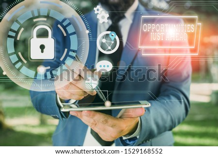 Text sign showing Opportunities Just Ahead. Conceptual photo Advantageous circumstances Perseverance pays off Male human wear formal work suit presenting presentation using smart device.