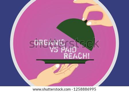 Text sign showing Organic Vs Paid Reach. Conceptual photo Increasing followers naturally or by paying for it Hu analysis Hands Serving Tray Platter and Lifting the Lid inside Color Circle.