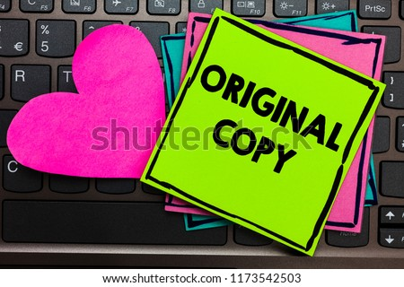 Text sign showing Original Copy. Conceptual photo Main Script Unprinted Branded Patented Master List Papers Romantic lovely message Heart Keyboard Type computer Good feelings. #1173542503