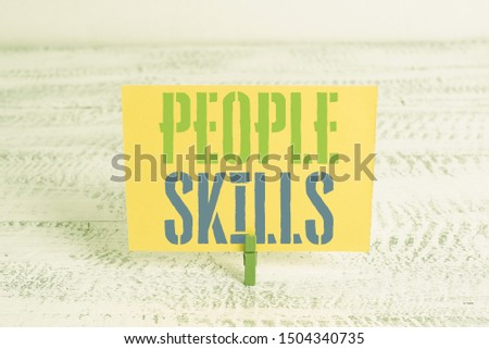 Text sign showing People Skills. Conceptual photo Get Along well Effective Communication Rapport Approachable Green clothespin white wood background colored paper reminder office supply.