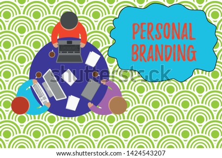 Text sign showing Personal Branding. Conceptual photo Practice of People Marketing themselves Image as Brands Working round table male employees electronic devices documents coffee cup.