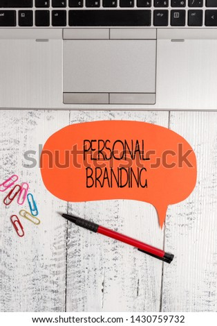 Text sign showing Personal Branding. Conceptual photo Practice of People Marketing themselves Image as Brands Open laptop blank speech bubble pen ballpoint colored clips vintage wooden.