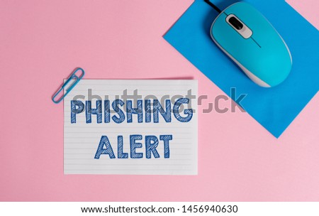 Text sign showing Phishing Alert. Conceptual photo aware to fraudulent attempt to obtain sensitive information Wire electronic mouse striped blank paper sheets clip colored background.