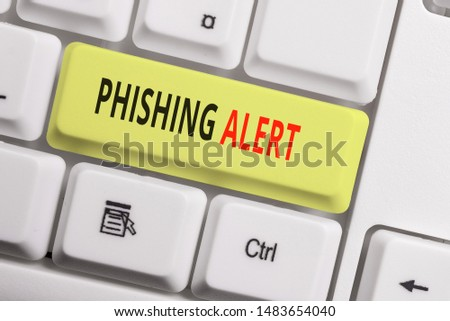 Text sign showing Phishing Alert. Conceptual photo aware to fraudulent attempt to obtain sensitive information White pc keyboard with empty note paper above white background key copy space.