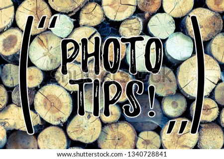 Text sign showing Photo Tips. Conceptual photo Suggestions to take good pictures Advices for great photography Wooden background vintage wood wild message ideas intentions thoughts.