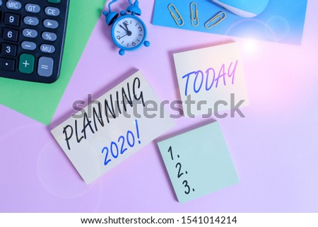 Text sign showing Planning 2020. Conceptual photo process of making plans for something next year Wire mouse portable calculator notepads paper sheets clips color background.