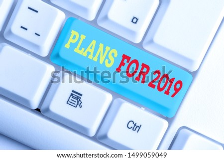 Text sign showing Plans For 2019. Conceptual photo an intention or decision about what one is going to do White pc keyboard with empty note paper above white background key copy space. #1499059049