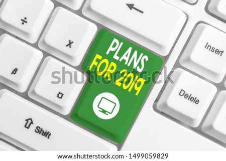Text sign showing Plans For 2019. Conceptual photo an intention or decision about what one is going to do White pc keyboard with empty note paper above white background key copy space. #1499059829