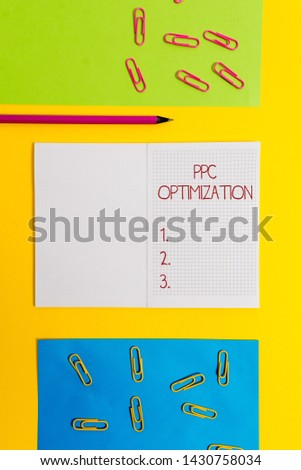 Text sign showing Ppc Optimization. Conceptual photo Enhancement of search engine platform for pay per click Blank squared notebook pencil marker paper sheets plain colored background.