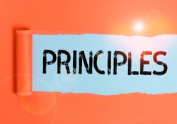 Text sign showing Principles. Conceptual photo fundamental truth that serves as the base for a system of belief Cardboard which is torn in the middle placed above a plain table backdrop.