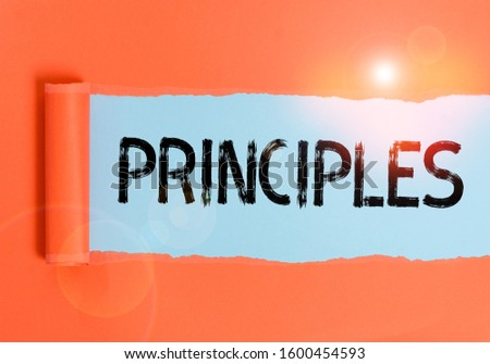 Text sign showing Principles. Conceptual photo fundamental truth that serves as the base for a system of belief Cardboard which is torn in the middle placed above a plain table backdrop. Сток-фото ©