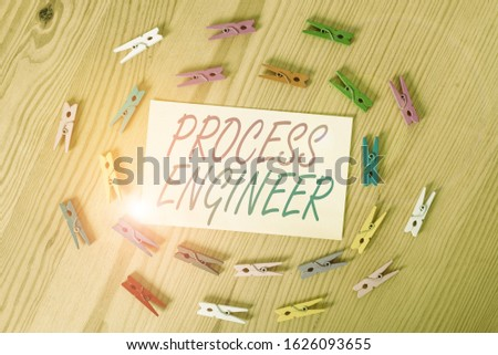 Text sign showing Process Engineer. Conceptual photo responsible for developing new industrial processes Colored clothespin papers empty reminder wooden floor background office.
