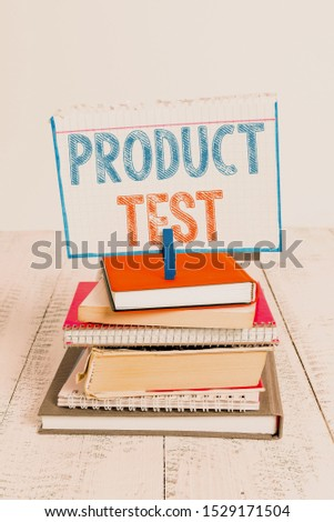 Text sign showing Product Test. Conceptual photo process of measuring the properties or perforanalysisce of products pile stacked books notebook pin clothespin colored reminder white wooden. #1529171504