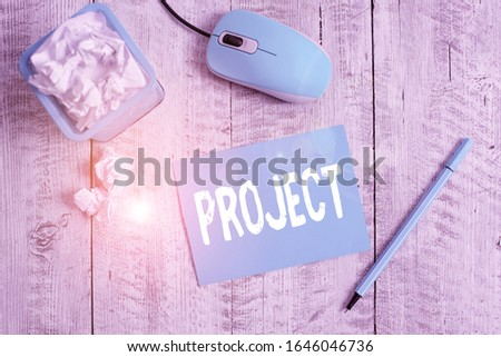 Text sign showing Project. Conceptual photo Planned work activity Study of particular subject Creative job Crumpled paper in bin and computer mouse with stationary on wooden backdrop.