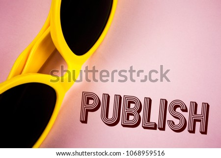 Text sign showing Publish. Conceptual photo Make information available to people Issue a written product written on Plain Pink background Sunglasses next to it. #1068959516