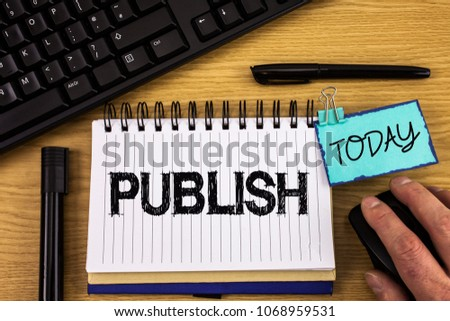 Text sign showing Publish. Conceptual photo Make information available to people Issue a written product written on Noteoad on wooden background Hand on Mouse Today Pen Keyboard #1068959531
