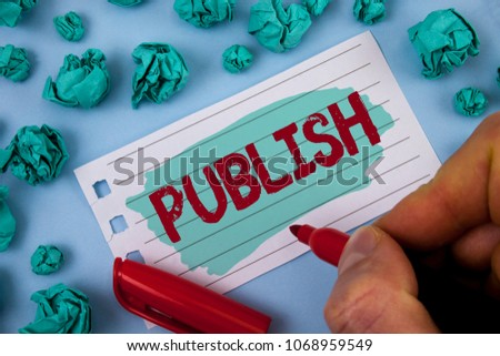 Text sign showing Publish. Conceptual photo Make information available to people Issue a written product written by Man on Painted Notepad Paper holding Marker plain background Paper Balls. #1068959549