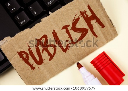 Text sign showing Publish. Conceptual photo Make information available to people Issue a written product written on Tear Cardboard Piece on plain background Keyboard and Marker next to it. #1068959579