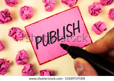 Text sign showing Publish. Conceptual photo Make information available to people Issue a written product written by Man on Sticky Note paper holding Marker on plain background Paper Balls. #1068959588