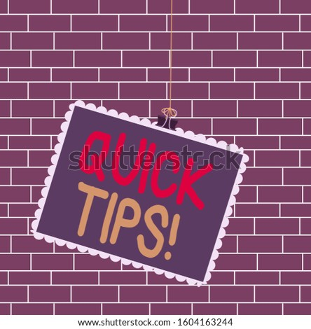 Text sign showing Quick Tips. Conceptual photo small but particularly useful piece of practical advice Stamp stuck binder clip paper clips square color frame rounded tip sticker.