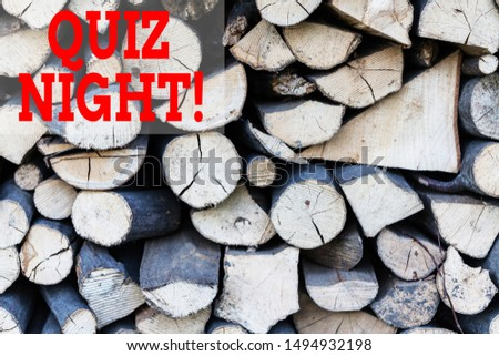Text sign showing Quiz Night. Conceptual photo evening test knowledge competition between individuals Background dry chopped firewood logs stacked up in a pile winter chimney.