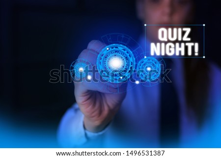 Text sign showing Quiz Night. Conceptual photo evening test knowledge competition between individuals Woman wear formal work suit presenting presentation using smart device.