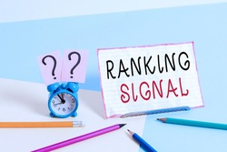 Text sign showing Ranking Signal. Conceptual photo characteristic of a website that search engine algorithms Mini size alarm clock beside stationary placed tilted on pastel backdrop.
