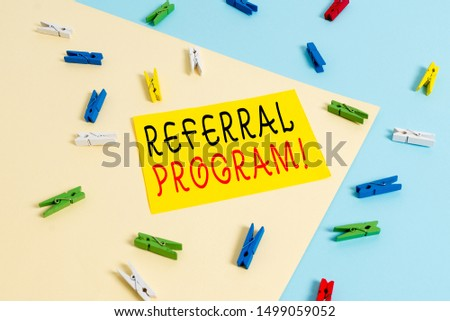 Text sign showing Referral Program. Conceptual photo internal recruitment method employed by organizations Colored clothespin paper empty reminder yellow blue floor background office. #1499059052