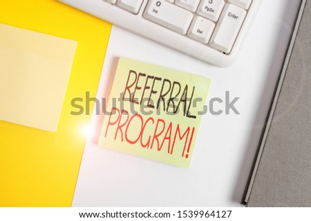 Text sign showing Referral Program. Conceptual photo internal recruitment method employed by organizations Empty blank paper with copy space and pc keyboard above orange background table. #1539964127