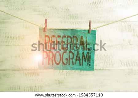 Text sign showing Referral Program. Conceptual photo internal recruitment method employed by organizations Clothesline clothespin rectangle shaped paper reminder white wood desk.