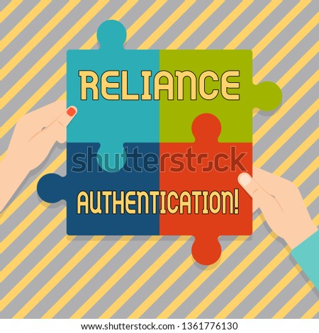 Text sign showing Reliance Authentication. Conceptual photo part of trust based identity attribution process Four Blank Multi Color Jigsaw Puzzle Tile Pieces Put Together by Human Hands.