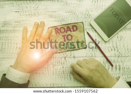 Text sign showing Road To Results. Conceptual photo Business direction Path Result Achievements Goals Progress Hand hold note paper near writing equipment and modern smartphone device.