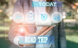 Text sign showing Road Trip. Conceptual photo Roaming around places with no definite or exact target location Female human wear formal work suit presenting presentation use smart device.