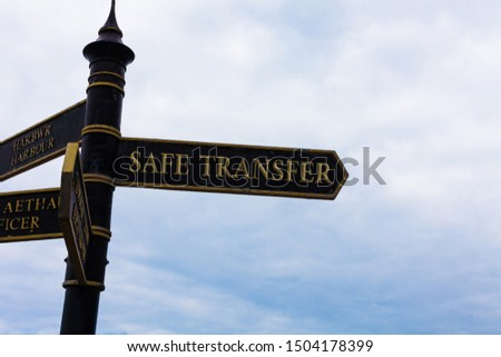 Text sign showing Safe Transfer. Conceptual photo Wire Transfers electronically Not paper based Transaction Road sign on the crossroads with blue cloudy sky in the background. #1504178399