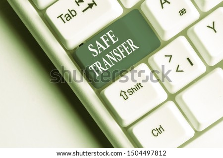 Text sign showing Safe Transfer. Conceptual photo Wire Transfers electronically Not paper based Transaction White pc keyboard with empty note paper above white background key copy space. #1504497812