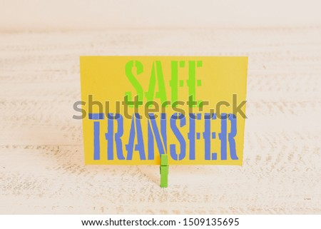 Text sign showing Safe Transfer. Conceptual photo Wire Transfers electronically Not paper based Transaction Green clothespin white wood background colored paper reminder office supply. #1509135695