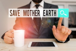 Text sign showing Save Mother Earth. Conceptual photo doing small actions prevent wasting water heat energy Male human wear formal clothes present presentation use hi tech smartphone.