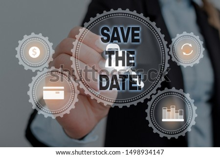 Text sign showing Save The Date. Conceptual photo Organizing events well make day special event organizers Woman wear formal work suit presenting presentation using smart device.