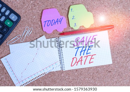 Text sign showing Save The Date. Conceptual photo Systematized events Scheduled activity Recorded Filed Desk notebook paper office cardboard paperboard study supplies table chart.