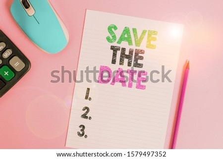 Text sign showing Save The Date. Conceptual photo Systematized events Scheduled activity Recorded Filed Electronic calculator wire mouse striped sheet pencil colored background.