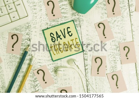 Text sign showing Save The Date question. Conceptual photo asking someone to remember specific day or time Writing tools, computer stuff and scribbled paper on top of wooden table.