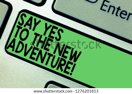 Text sign showing Say Yes To The New Adventure. Conceptual photo Exploring the world traveling life experience Keyboard key Intention to create computer message pressing keypad idea. #1276201813