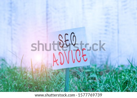 Text sign showing Seo Advice. Conceptual photo guidance or recommendations in enhancing the search engine Plain empty paper attached to a stick and placed in the green grassy land.