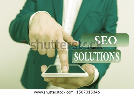 Text sign showing Seo Solutions. Conceptual photo Search Engine Result Page Increase Visitors by Rankings Businessman in the blue suite with lap top pointing with finger. #1507015346